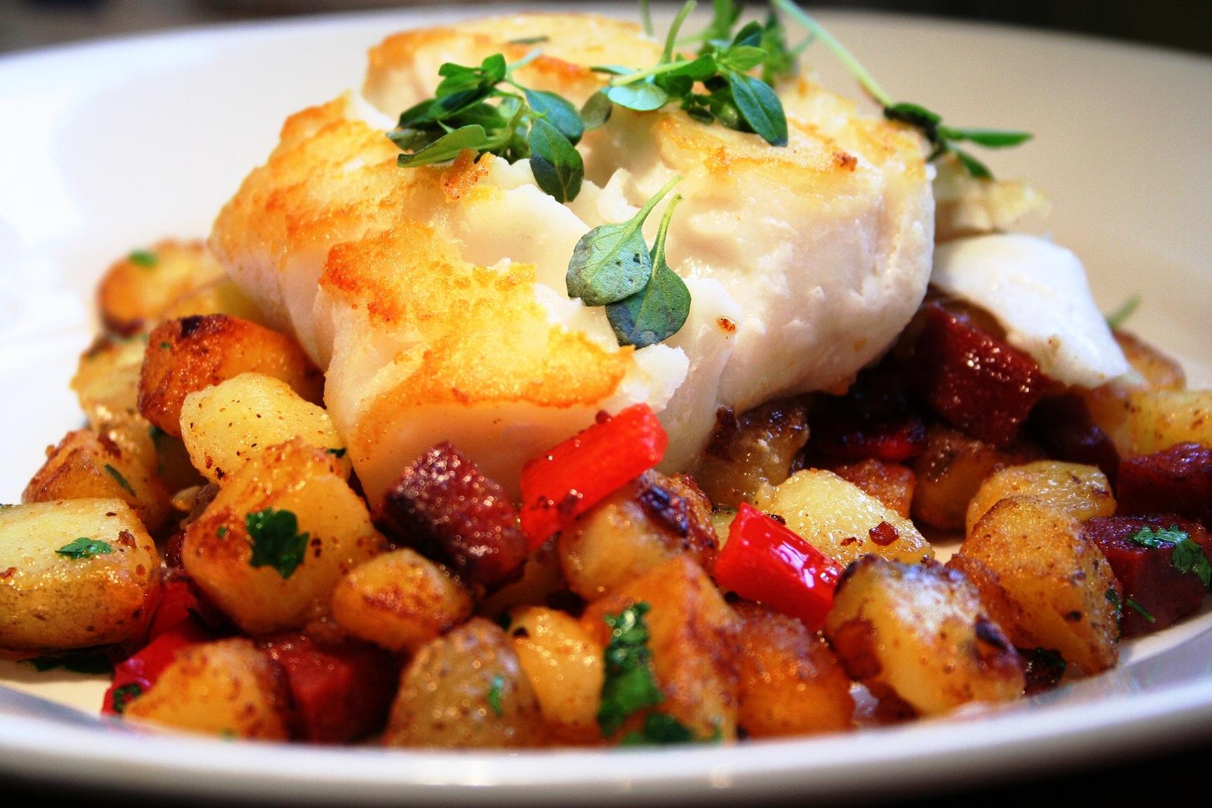 Pan fried cod with chorizo new potatoes greek basil for Fried cod fish recipes
